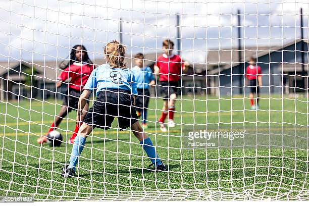 mixed gender soccer team makes a goal attempt - sports league stock pictures, royalty-free photos & images