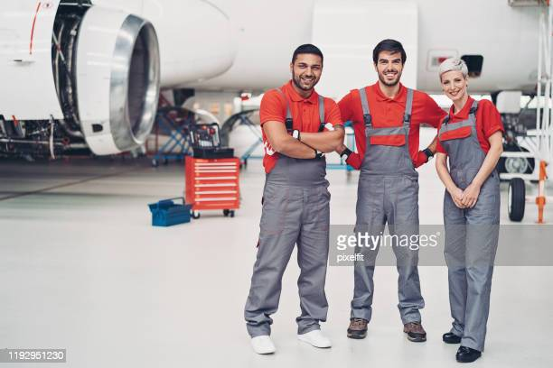 mixed group of airplane technicians - bib overalls stock pictures, royalty-free photos & images