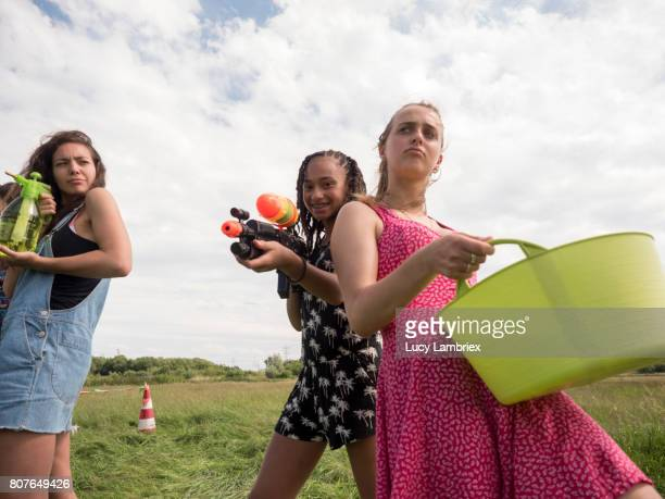 mixed group of girls posing with their weapons for a duel - wash bowl stock pictures, royalty-free photos & images