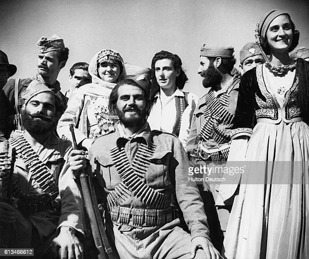 Mixed group of Greek irregular soldiers and partisans happily pose as they celebrate the liberation of their country at the end of the Second World...