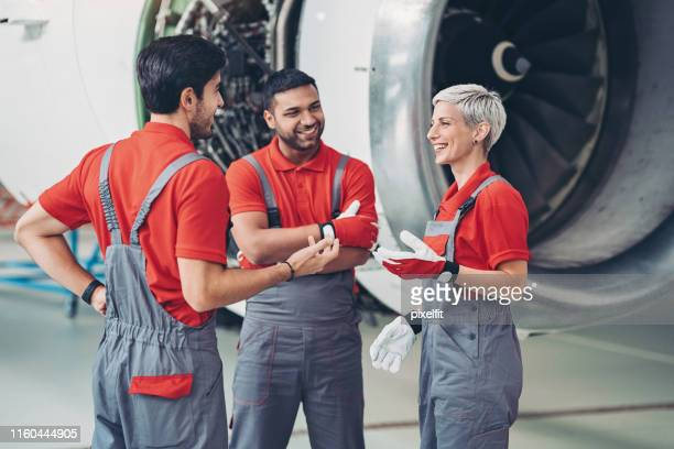 mixed group of mechanics - aerospace stock pictures, royalty-free photos & images