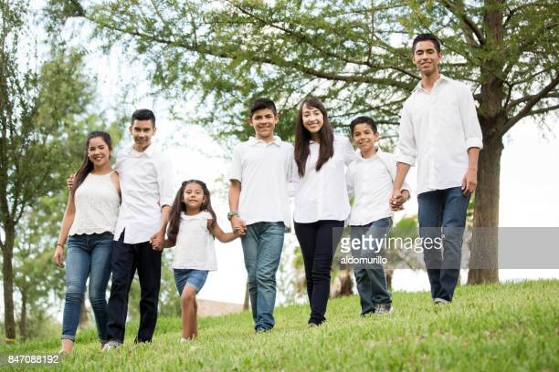 Mixed group of seven children and teenagers standing outdoors