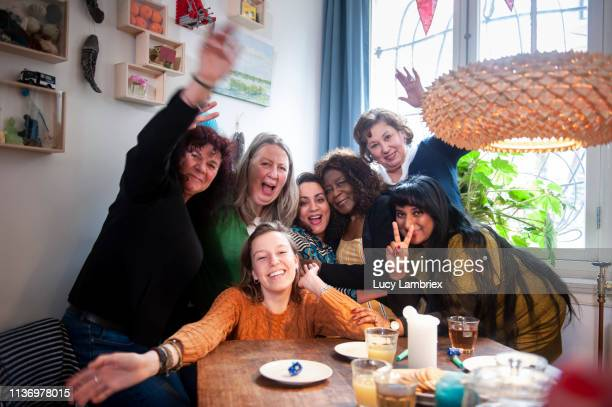 Mixed group of women celebrating friend's birthday with a party