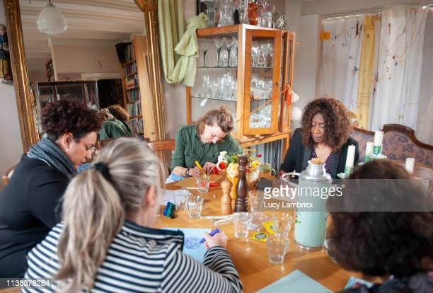 Mixed group of women participating in a creative workshop