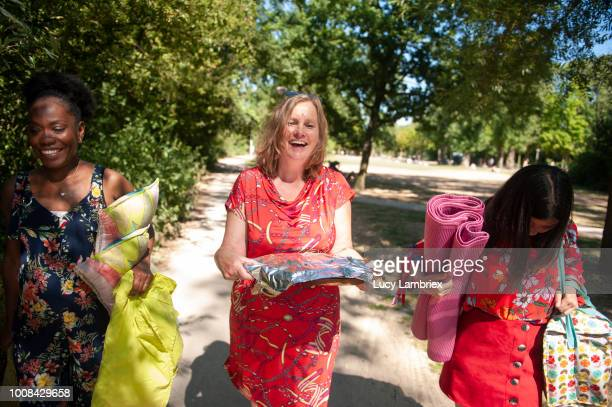Mixed group of women walking in the park, out on a picnic