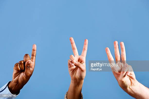mixed hands count out 1, 2, 3, against blue background - number 3 stock pictures, royalty-free photos & images