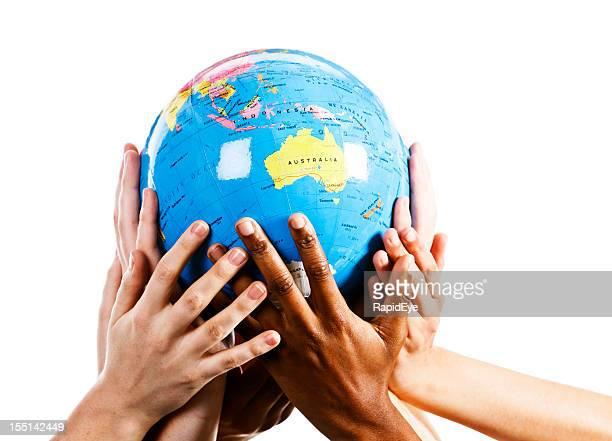 Mixed hands show environmental awareness by cradling a world globe