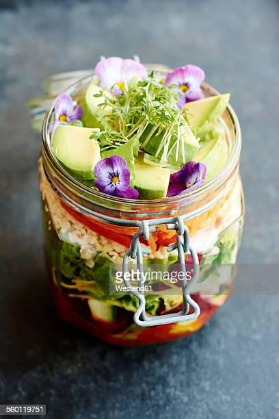 Mixed healthy salad in jar