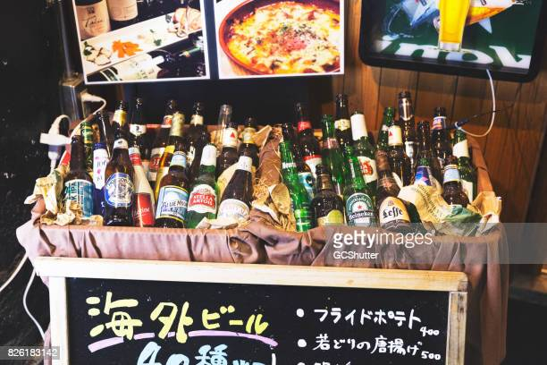 Mixed lot of several brands of alcohol on display outside a restaurant at Pontocho Street