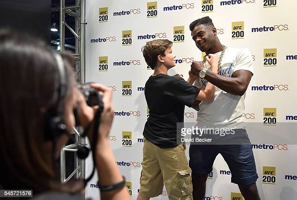 Mixed martial artist Aljamain Sterling poses with a young fan at the UFC Fan Expo at the Las Vegas Convention Center on July 9 2016 in Las Vegas...