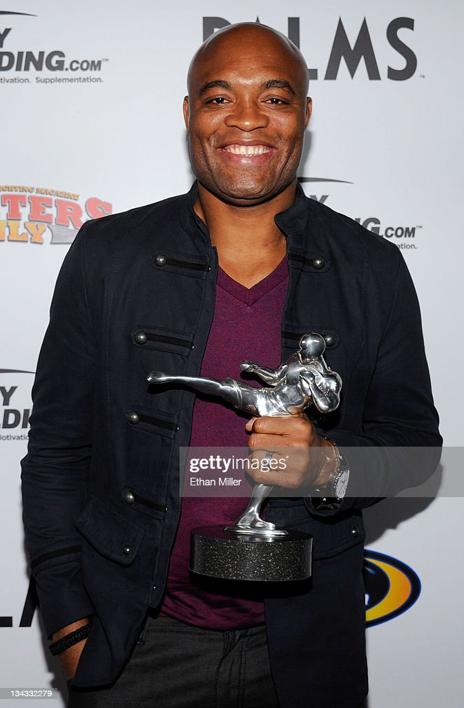 Mixed martial artist Anderson Silva holds the Knockout of the Year award for his victory over Vitor Belfort at UFC 126 at the Fighters Only World Mixed Martial Arts Awards 2011 at The Pearl concert theater at the Palms Casino Resort November 30, 2011 in Las Vegas, Nevada.