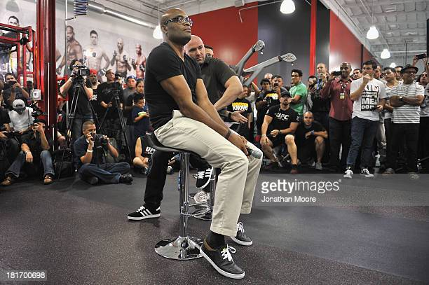 Mixed Martial Artist Anderson Silva listens along side UFC President Dana White during a QA session at UFC Gym on September 23 2013 in Torrance...