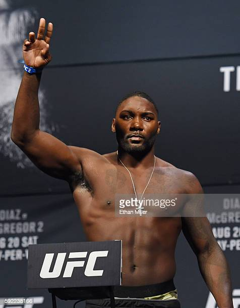 Mixed martial artist Anthony Johnson waves as he poses on the scale during his weighin for UFC 202 at MGM Grand Conference Center on August 19 2016...