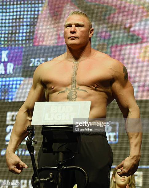Mixed martial artist Brock Lesnar poses on the scale during his weighin for UFC 200 at TMobile Arena on July 8 2016 in Las Vegas Nevada Lesnar will...