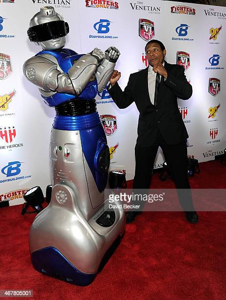Mixed martial artist Byron Smash Fields squares off with an iCan Showbot as he arrives at the sixth annual Fighters Only World Mixed Martial Arts...