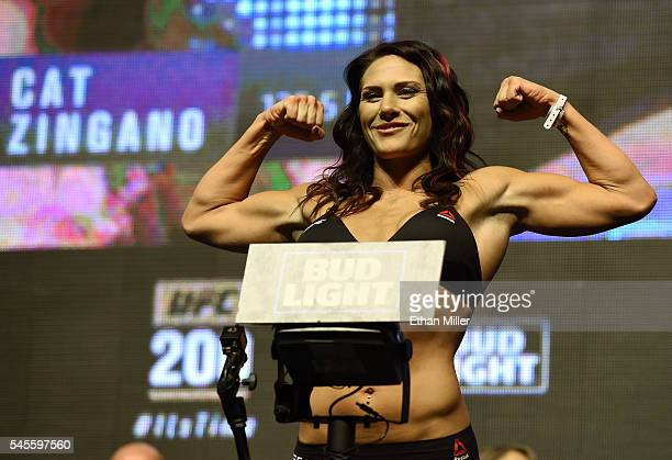 Mixed martial artist Cat Zingano poses on the scale during her weighin for UFC 200 at TMobile Arena on July 8 2016 in Las Vegas Nevada Zingano will...