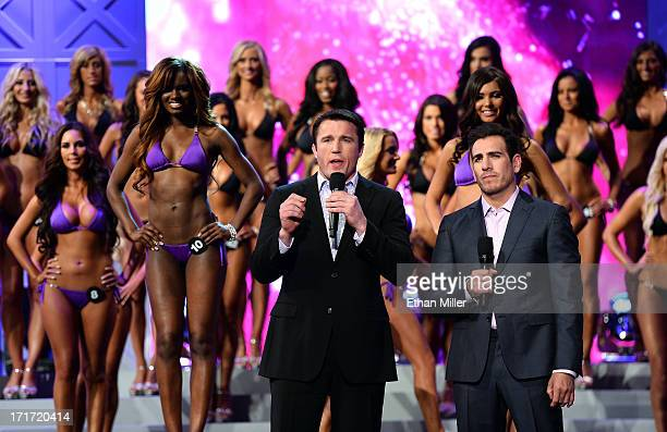 Mixed martial artist Chael Sonnen and former mixed martial artist Kenny Florian stand in front of contestants as they host the 17th annual Hooters...