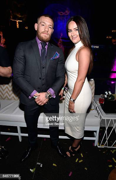 Mixed martial artist Conor McGregor and Dee Devlin attend his birthday celebration at Intrigue Nightclub at Wynn Las Vegas early July 10 2016 in Las...