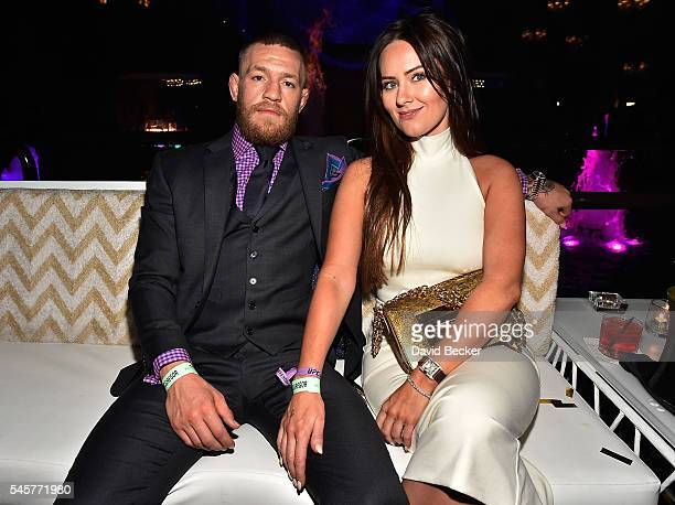 Mixed martial artist Conor McGregor and Dee Devlin attend his birthday celebration at Intrigue Nightclub at Wynn Las Vegas early July 10, 2016 in Las...