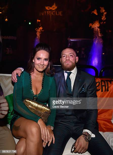 Mixed martial artist Conor McGregor and Dee Devlin celebrate his UFC 202 victory during the official afterfight party at Intrigue Nightclub at Wynn...