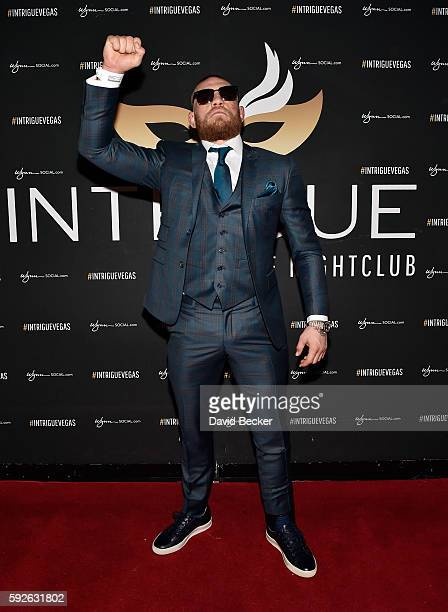 Mixed martial artist Conor McGregor arrives at the official afterfight party to celebrate his UFC 202 victory at Intrigue Nightclub at Wynn Las Vegas...