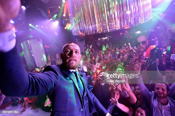 Mixed martial artist Conor McGregor celebrates his UFC 202 victory during the official afterfight party at Intrigue Nightclub at Wynn Las Vegas on...