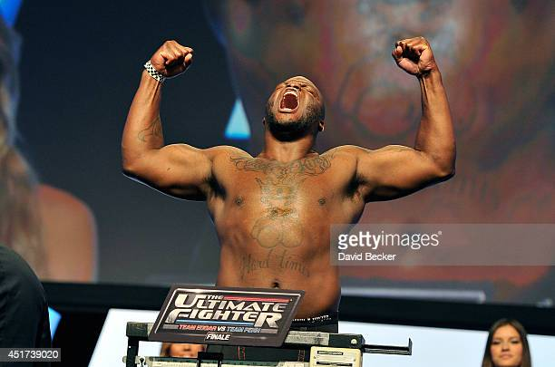Mixed martial artist Derrick Lewis poses on the scale during the TUF 19 Finale weighin at the Mandalay Bay Convention Center on July 5 2014 in Las...
