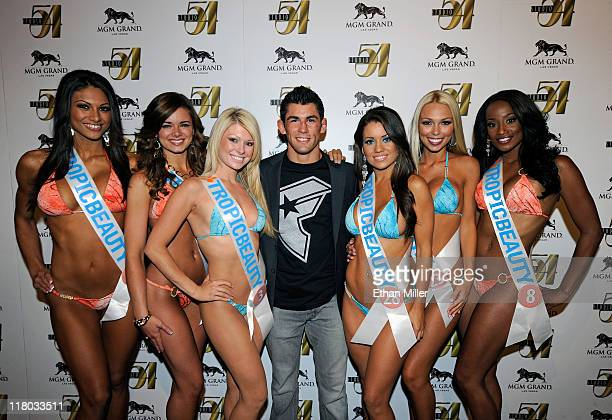 Mixed martial artist Dominick Cruz and Tropic Beauty Model Search contestants arrive at a postfight party for UFC 132 at Studio 54 inside the MGM...