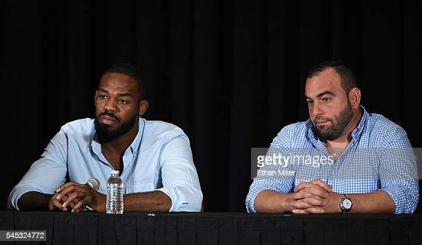 Mixed martial artist Jon Jones and his manager Malki Kawa take questions during a news conference at MGM Grand Hotel & Casino to address Jones being...