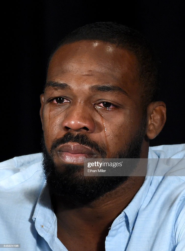 Mixed martial artist Jon Jones cries as he speaks during a news conference at MGM Grand Hotel & Casino to address being pulled from his light heavyweight title fight at UFC 200 against Daniel Cormier due to a potential violation of the UFC's anti-doping policy on July 7, 2016 in Las Vegas, Nevada.