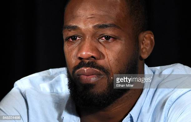 Mixed martial artist Jon Jones cries as he speaks during a news conference at MGM Grand Hotel Casino to address being pulled from his light...