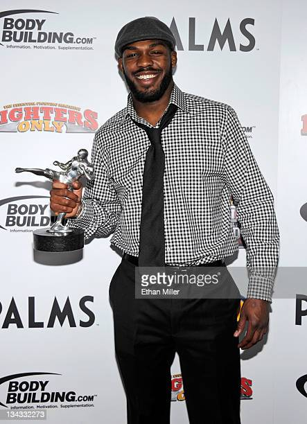 Mixed martial artist Jon Jones holds the Fighter of the Year award at the Fighters Only World Mixed Martial Arts Awards 2011 at The Pearl concert...