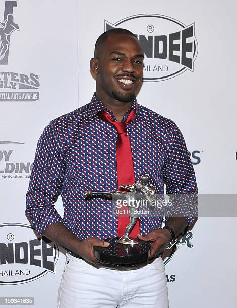 Mixed martial artist Jon Jones holds the Fighter of the Year award at the Fighters Only World Mixed Martial Arts Awards at the Hard Rock Hotel &...