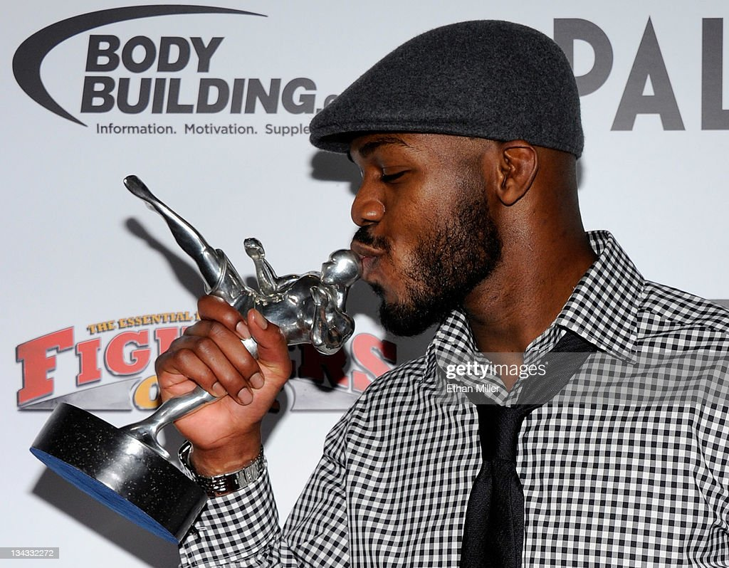 Mixed martial artist Jon Jones kisses his Fighter of the Year award at the Fighters Only World Mixed Martial Arts Awards 2011 at The Pearl concert theater at the Palms Casino Resort November 30, 2011 in Las Vegas, Nevada.