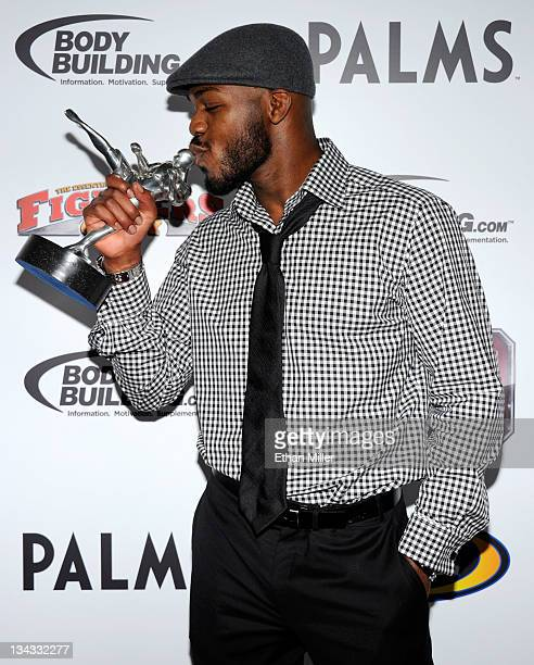 Mixed martial artist Jon Jones kisses his Fighter of the Year award at the Fighters Only World Mixed Martial Arts Awards 2011 at The Pearl concert...