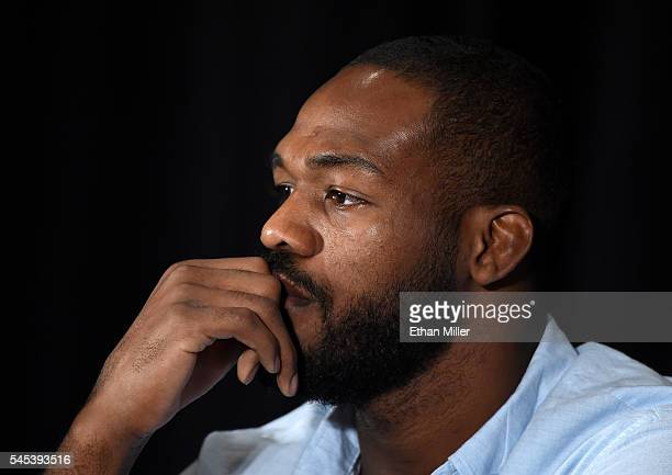 Mixed martial artist Jon Jones listens during a news conference at MGM Grand Hotel Casino to address being pulled from his light heavyweight title...