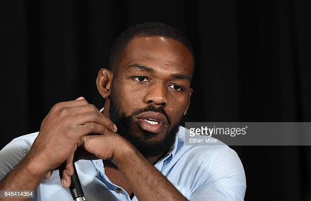 Mixed martial artist Jon Jones listens during a news conference at MGM Grand Hotel & Casino to address being pulled from his light heavyweight title...
