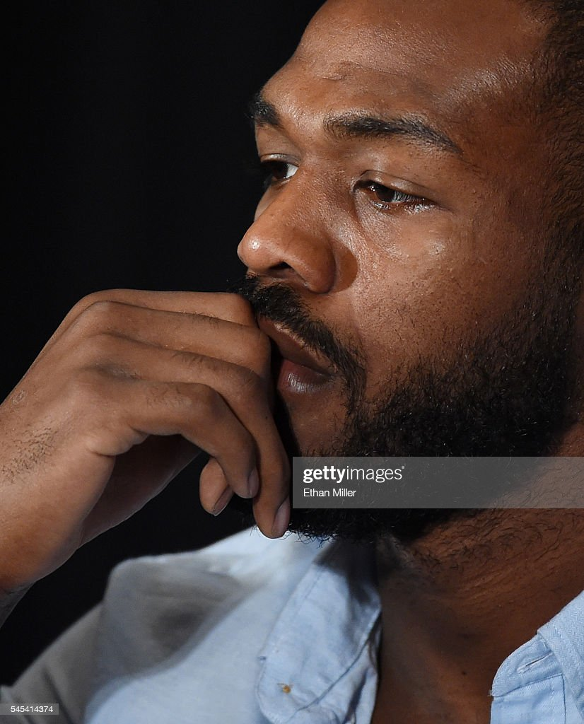 Mixed martial artist Jon Jones listens during a news conference at MGM Grand Hotel & Casino to address being pulled from his light heavyweight title fight at UFC 200 against Daniel Cormier due to a potential violation of the UFC's anti-doping policy on July 7, 2016 in Las Vegas, Nevada.