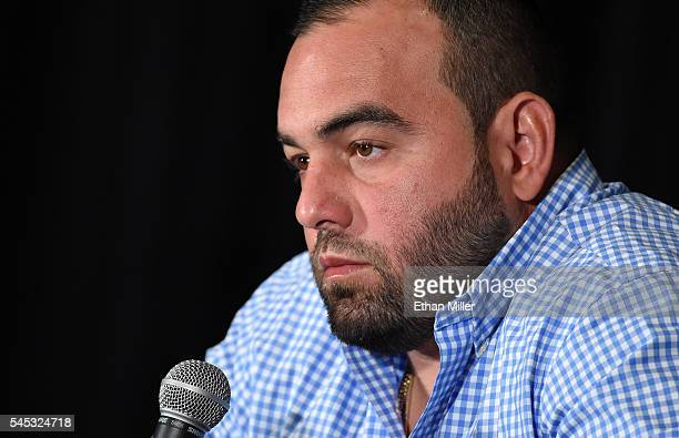 Mixed martial artist Jon Jones' manager Malki Kawa speaks during a news conference at MGM Grand Hotel Casino to address Jones being pulled from his...