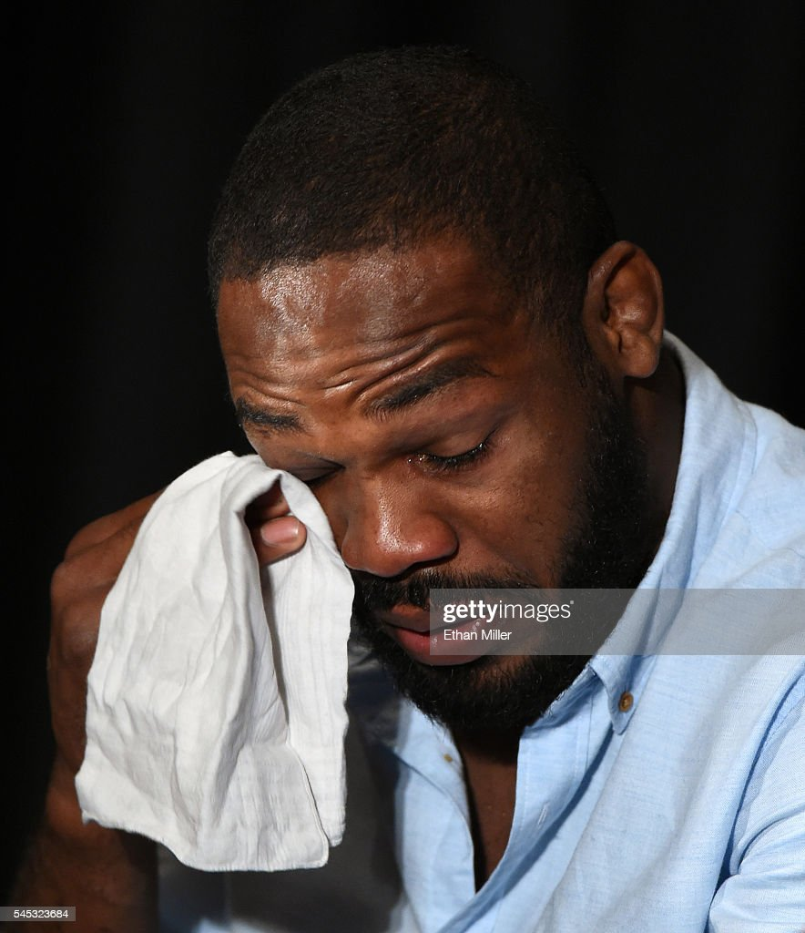 Mixed martial artist Jon Jones wipes away tears while speaking during a news conference at MGM Grand Hotel & Casino to address being pulled from his light heavyweight title fight at UFC 200 against Daniel Cormier due to a potential violation of the UFC's anti-doping policy on July 7, 2016 in Las Vegas, Nevada.