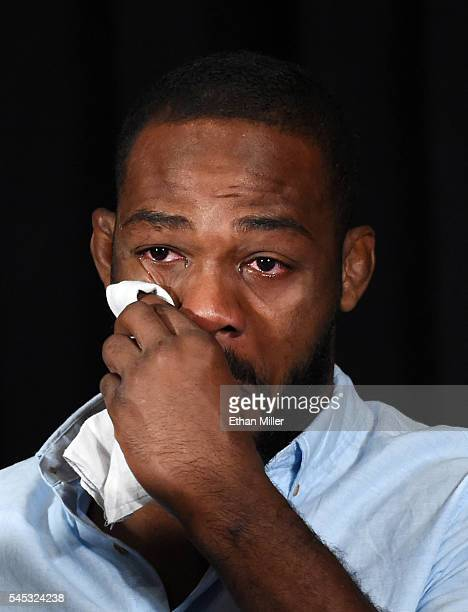 Mixed martial artist Jon Jones wipes away tears while speaking during a news conference at MGM Grand Hotel & Casino to address being pulled from his...