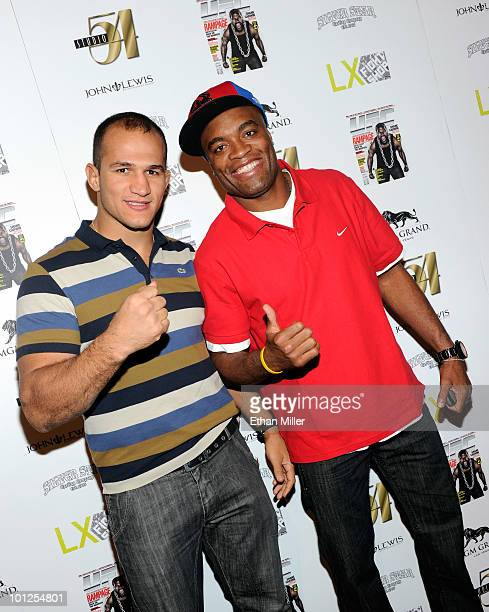 Mixed martial artist Junior Dos Santos and mixed martial artist and UFC Middleweight Champion Anderson Silva arrive at the official Silver Star...