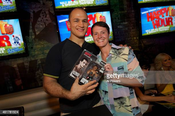 Mixed martial artist Junior Dos Santos signs an autograph for a fan at the UFC Brazilian party during UFC International Fight Week inside the...