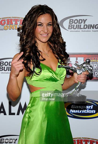 Mixed martial artist Miesha Tate holds the Female Fighter of the Year award at the Fighters Only World Mixed Martial Arts Awards 2011 at The Pearl...