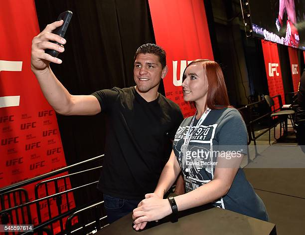 Mixed martial artist Nick Diaz meets with a fan at the UFC Fan Expo at the Las Vegas Convention Center on July 8 2016 in Las Vegas Nevada