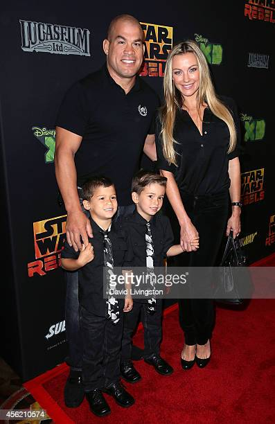 Mixed martial artist Tito Ortiz Amber Nichole Miller and his sons Jesse Jameson Ortiz and Journey Jett Ortiz attend a screening of Disney XD's Star...