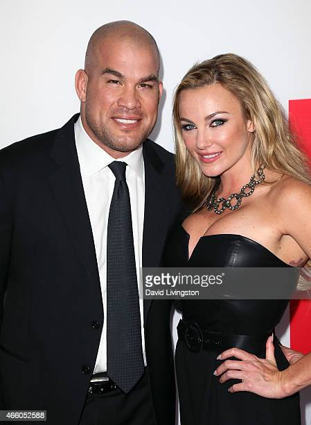 Mixed martial artist Tito Ortiz and Amber Nichole Miller attend the premiere of Open Road Films' The Gunman at Regal Cinemas LA Live on March 12 2015...