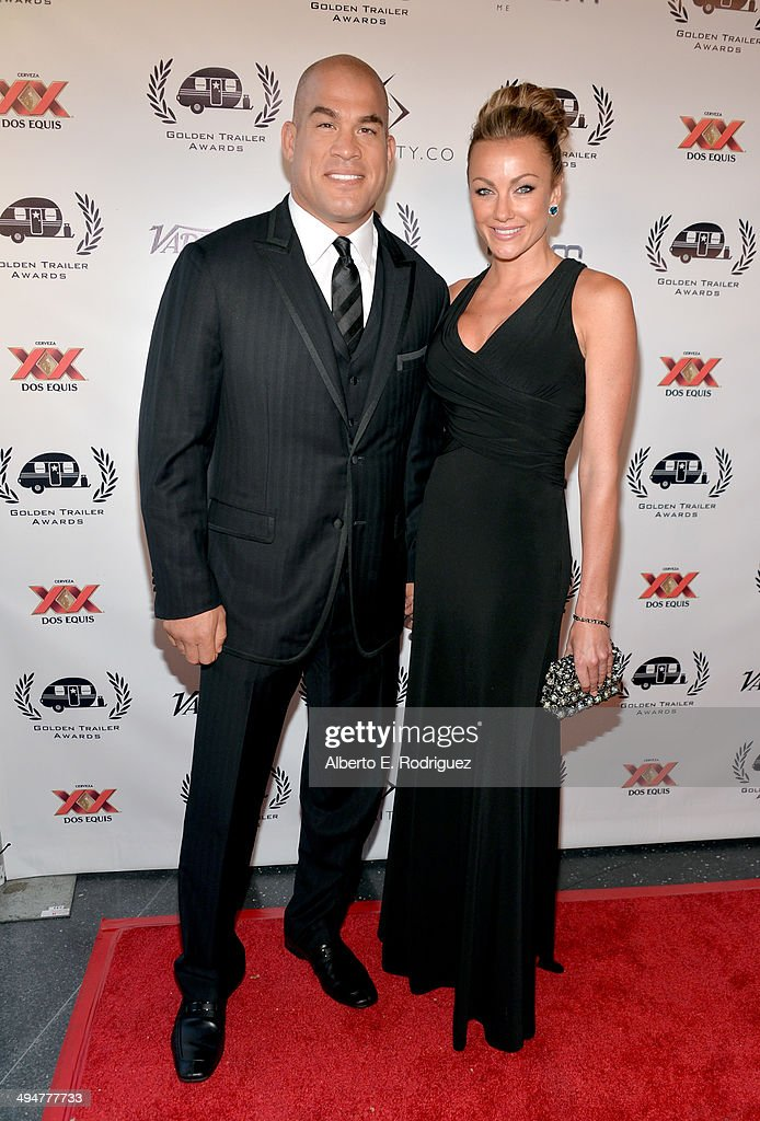 Mixed martial artist Tito Ortiz (L) and model Amber Miller attend the 15th Annual Golden Trailer Awards at Saban Theatre on May 30, 2014 in Beverly Hills, California.