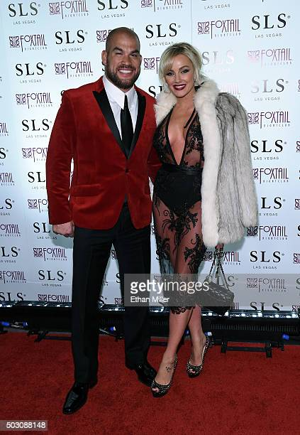 Mixed martial artist Tito Ortiz and model Amber Nichole Miller arrive at SLS Las Vegas for a New Year's Eve celebration on December 31 2015 in Las...