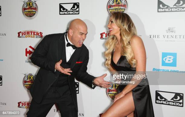 Mixed martial artist Tito Ortiz jokes around with television personality Amber Nichole Miller as they attend the ninth annual Fighters Only World...